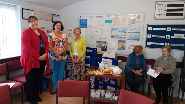 PPG members in the surgeyr waiting room serving hot drinks and cake